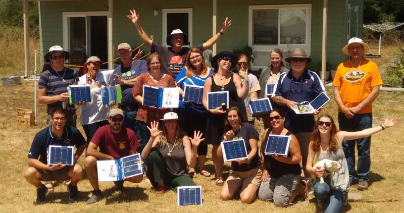 Educators at the 2016 Solar Schoolhouse Summer Institute share one of their creations – solar notebook cellphone & emergency lighting chargers.