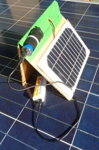 Solar Notebook Charger (v. NB3B) shown charging a powerbank.