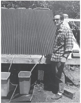 Freeman Ford tesing one of the many configurations of his revolutionary plastic solar pool heating panels. (1970s)