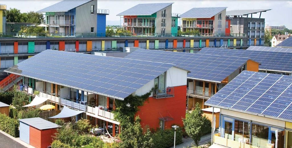 Microgrids: This is the Solar Settlement in Freiburg, Germany. A 59-home community, it is the first in the world to have a positive energy balance, with each home producing $5,600 per year in solar energy profits. The way to positive energy is designing homes that are extraordinarily energy efficient, what designer Rolf Disch calls PlusEnergy.